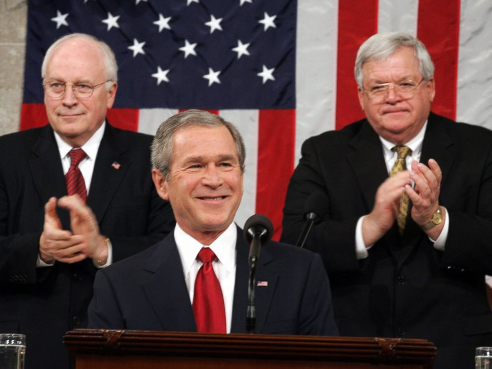PHOTO: President George W. Bush, center, is applauded by Vice President Dick Cheney, left, and Speaker of the House Dennis Hastert, right, during Bushs State of the Union address at the U.S. Capitol in Washington, D.C. on Feb. 2, 2005.