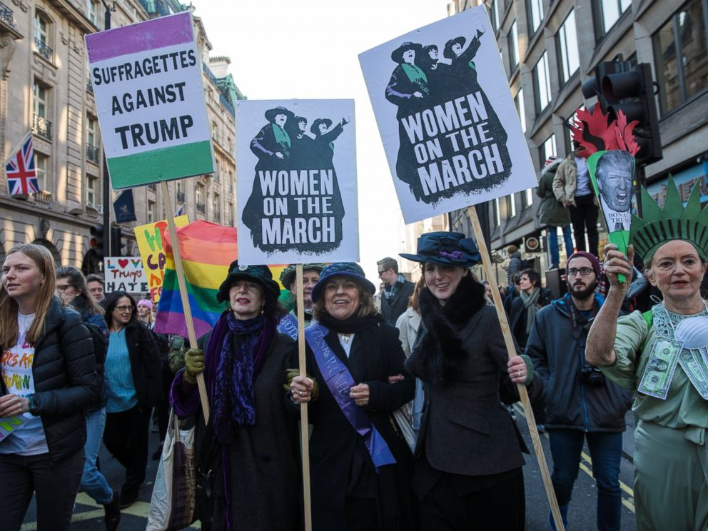 PHOTO: Protesters in costume holding placards march from The US Embassy in Grosvenor Square towards Trafalgar Square during the Womens March, Jan. 21, 2017, in London, England.