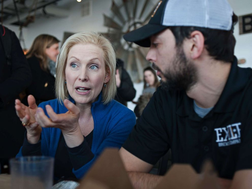 PHOTO: Senator Kirsten Gillibrand (D-NY) speaks with patrons at the Scenic Route Bakery in the East Village of Des Moines, Iowa, Jan. 19, 2019, after she spoke at the third annual Womens March at the Iowa State Capitol.
