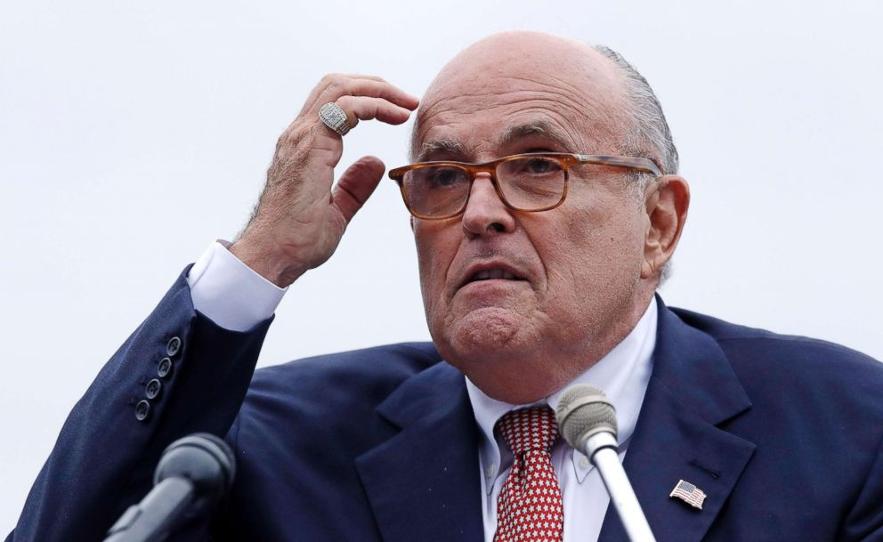 Rudy Giuliani, an attorney for President Donald Trump, addresses a gathering during a campaign event for Eddie Edwards, who is running for the U.S. Congress, in Portsmouth, N.H., Aug. 1, 2018.