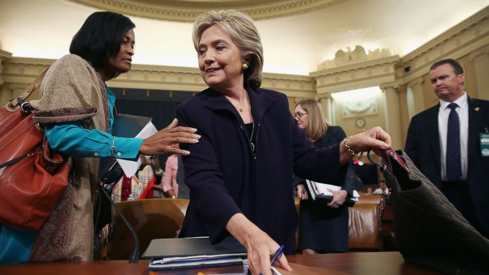 Cheryl Mills (L) and Hillary Clinton take a break in a hearing of the House Select Committee on Benghazi, Oct. 22, 2015, on Capitol Hill in Washington.