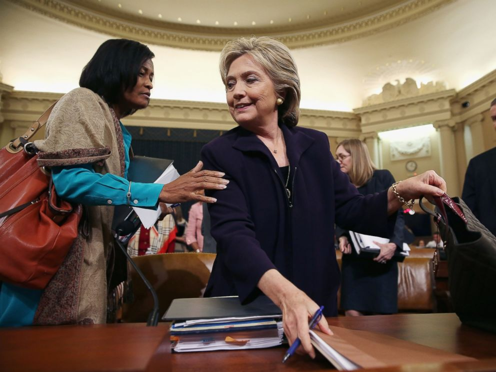 PHOTO: Cheryl Mills (L) and Hillary Clinton take a break in a hearing of the House Select Committee on Benghazi, Oct. 22, 2015, on Capitol Hill in Washington.