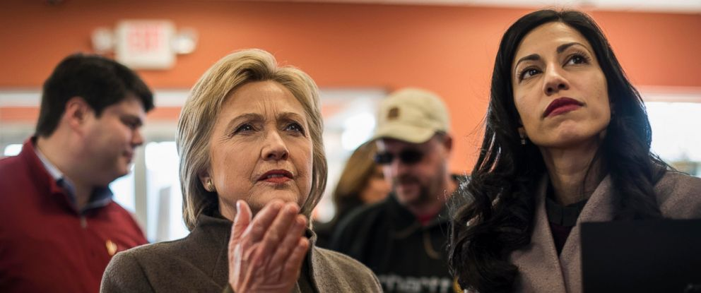 PHOTO: Meeting voters and picking up food for the road, Hillary Clinton, accompanied by Senior Staffer Huma Abedin, stops at a Dunkin Donuts in Manchester, New Hampshire, Feb. 7, 2016.