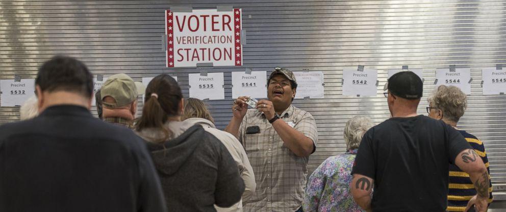 PHOTO: Caucusgoers register to vote at a Republican caucus location in Las Vegas, Feb. 23, 2016.