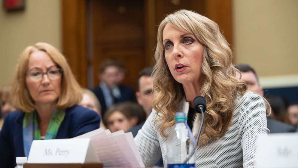 USA Gymnastics President and CEO Kerry Perry, center, joined at left by U.S. Olympic Committee Acting CEO Susanne Lyons, testifies before the House Commerce Oversight and Investigations Subcommittee about the Olympic community's ability to protect athletes from sexual abuse, in Washington, May 23, 2018.