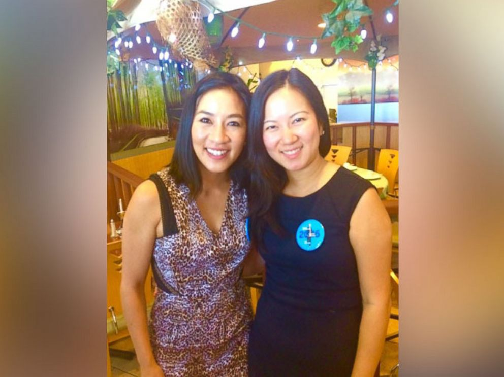 PHOTO: Angela Xin, 22, (right) with Olympic figure skater Michelle Kwan at a Democratic Party phone banking event in Nevada.