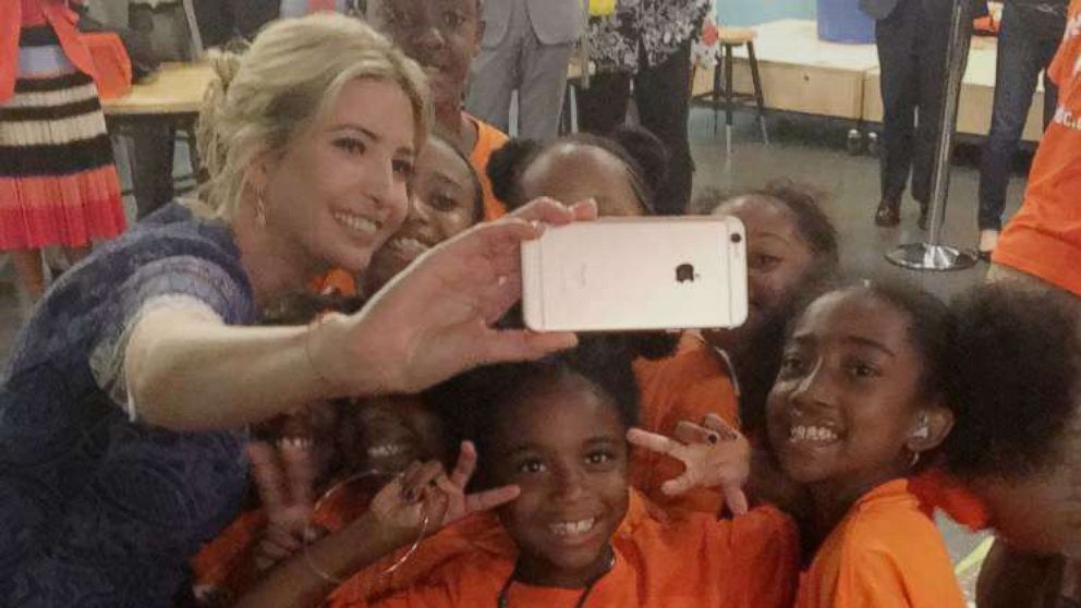 Ivanka Trump snaps selfies with girls at a reading event at the Smithsonian's National Museum of American History in Washington, D.C., on July 25, 2017.