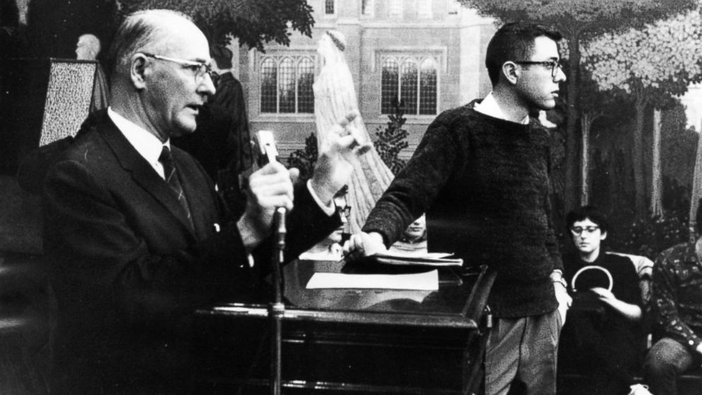 Bernie Sanders, right, member of the steering committee, stands next to George Beadle, University of Chicago president, who is speaking at a CORE meeting on housing sit-ins.