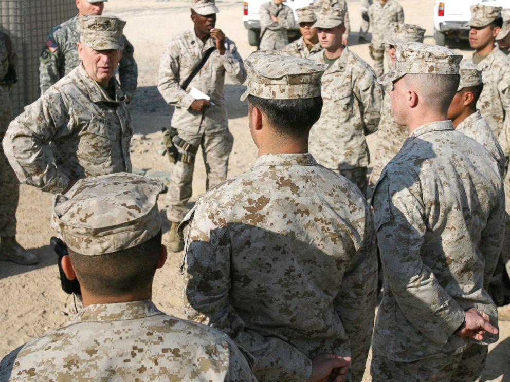 PHOTO: Lt. Gen. James M. Mattis, Commanding General, U.S. Marine Forces Central Command and 1st Marine Expeditionary Force, speaks with Marines during a visit to Camp Taqaddum, Iraq, Dec. 9, 2006.
