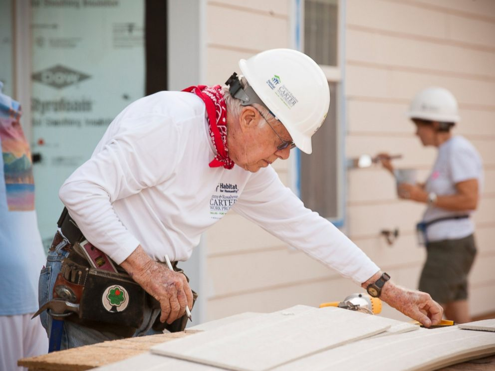 PHOTO: Former President Jimmy Carter helps to install siding on a new home during the 2014 Jimmy & Rosalynn Carter Work Project in Dallas.