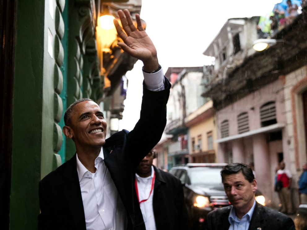 PHOTO: President Barack Obama waves to people as he enters a restaurant in Havana, Cuba, Sunday, March 20, 2016.