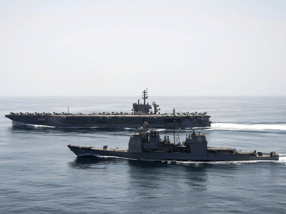 PHOTO: The aircraft carrier USS Theodore Roosevelt (CVN 71) and the guided-missile cruiser USS Normandy (CG 60) operate in the Arabian Sea conducting maritime security operations.