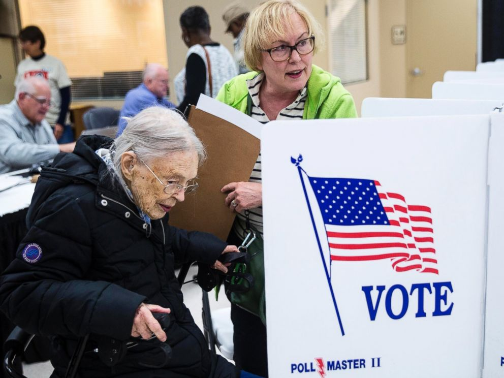 PHOTO: Rosemary Milburn, right, helps her mother Garvin Colburn cast her ballot during early voting at the Hamilton County Election Commission on Amnicola Highway, Oct. 22, 2016, in Chattanooga, Tennessee.