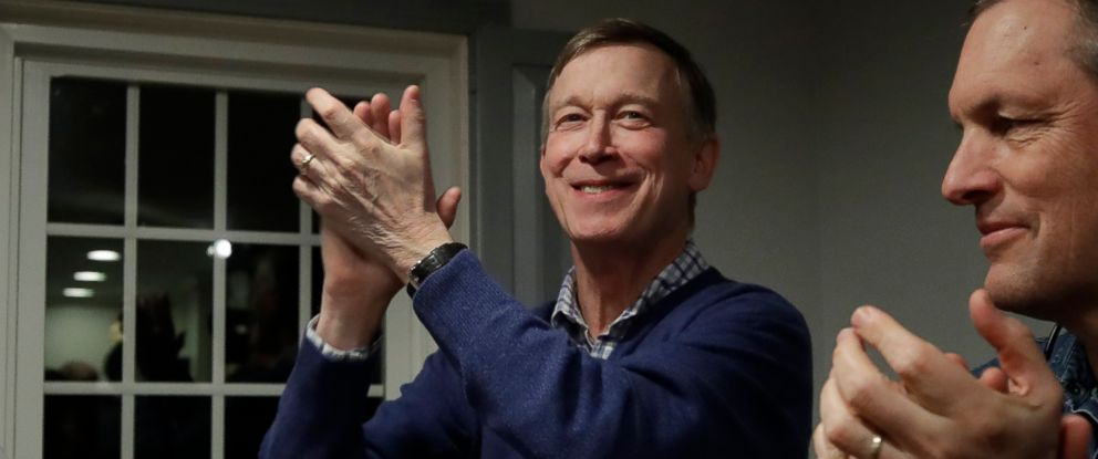 PHOTO: Former Colorado Gov. John Hickenlooper, left, applauds at a campaign house party, Feb. 13, 2019, in Manchester, N.H.