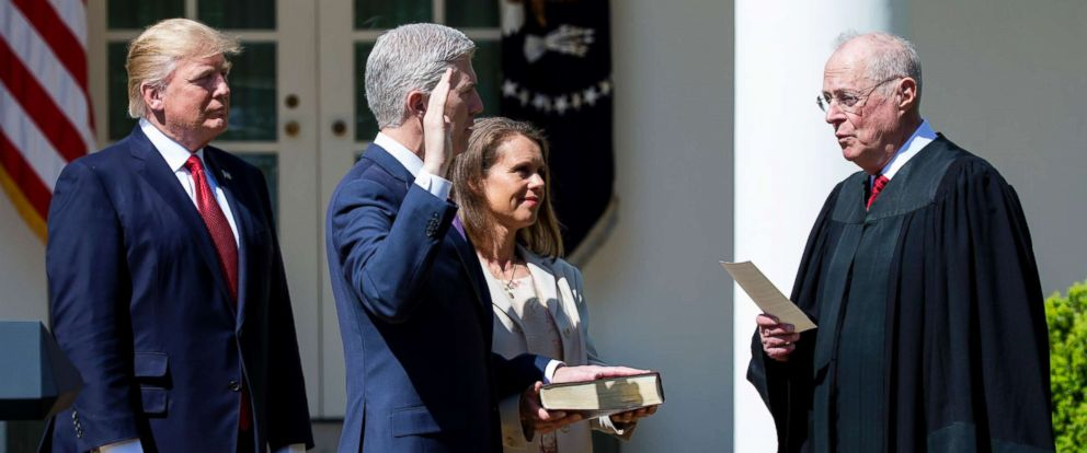 PHOTO: Supreme Court Associate Justice Anthony Kennedy administers the judicial oath to Judge Neil Gorsuch as President Donald Trump looks on during a ceremony in the Rose Garden at the White House, April 10, 2017 in Washington, D.C.