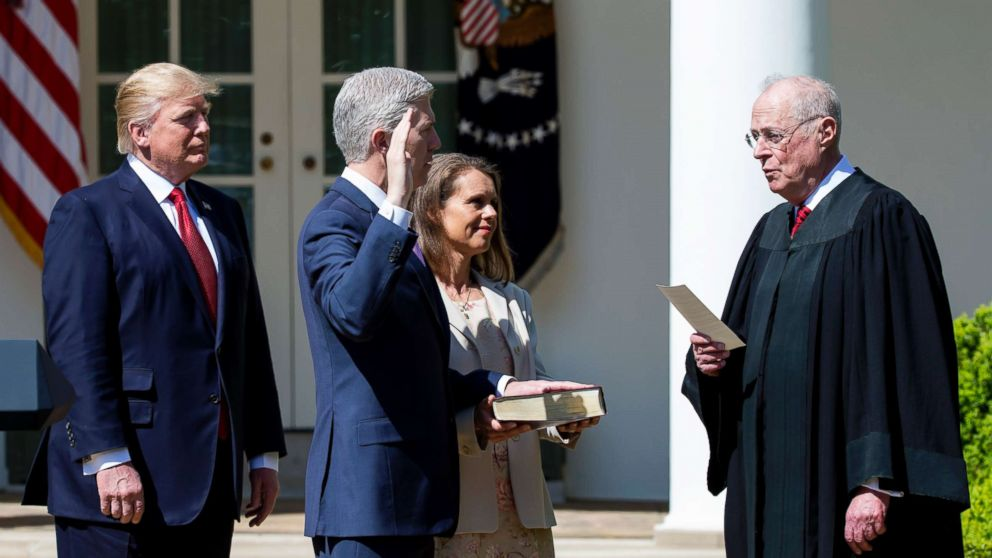 Supreme Court Associate Justice Anthony Kennedy administers the judicial oath to Judge Neil Gorsuch as President Donald Trump looks on during a ceremony in the Rose Garden at the White House, April 10, 2017 in Washington, D.C.