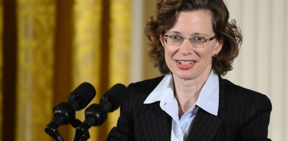 """PHOTO: Points of Light Foundation CEO Michelle Nunn makes brief remarks during the presentation of the 5,000th """"Points of Light"""" Foundation award with President Barack Obama in the White House in Washington, DC, July 15, 2013."""