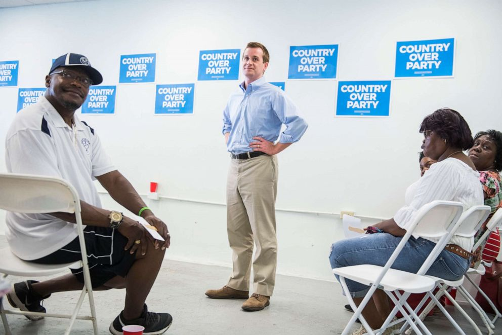 PHOTO: Dan McCready, Democratic candidate for North Carolinas 9th District, talks with voters at his campaign office in Elizabethtown, N.C., Aug. 10, 2019.