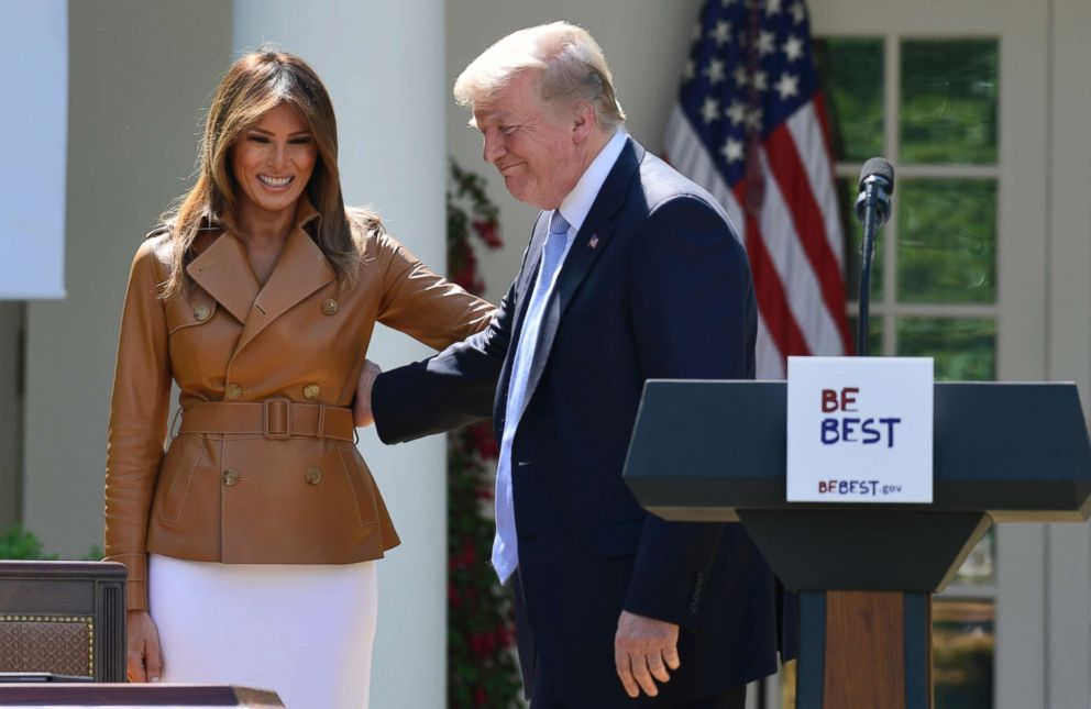 President Donald Trump stands next to first lady Melania Trump during an event where Melania Trump announced her initiatives in the Rose Garden of the White House in Washington, May 7, 2018.