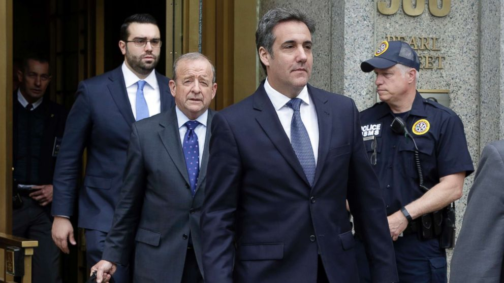 President Donald Trump's personal attorney Michael Cohen, right, leaves Federal Court, in New York, May 30, 2018, followed by members of his legal team, from left, Joseph Evans and Stephen Ryan.