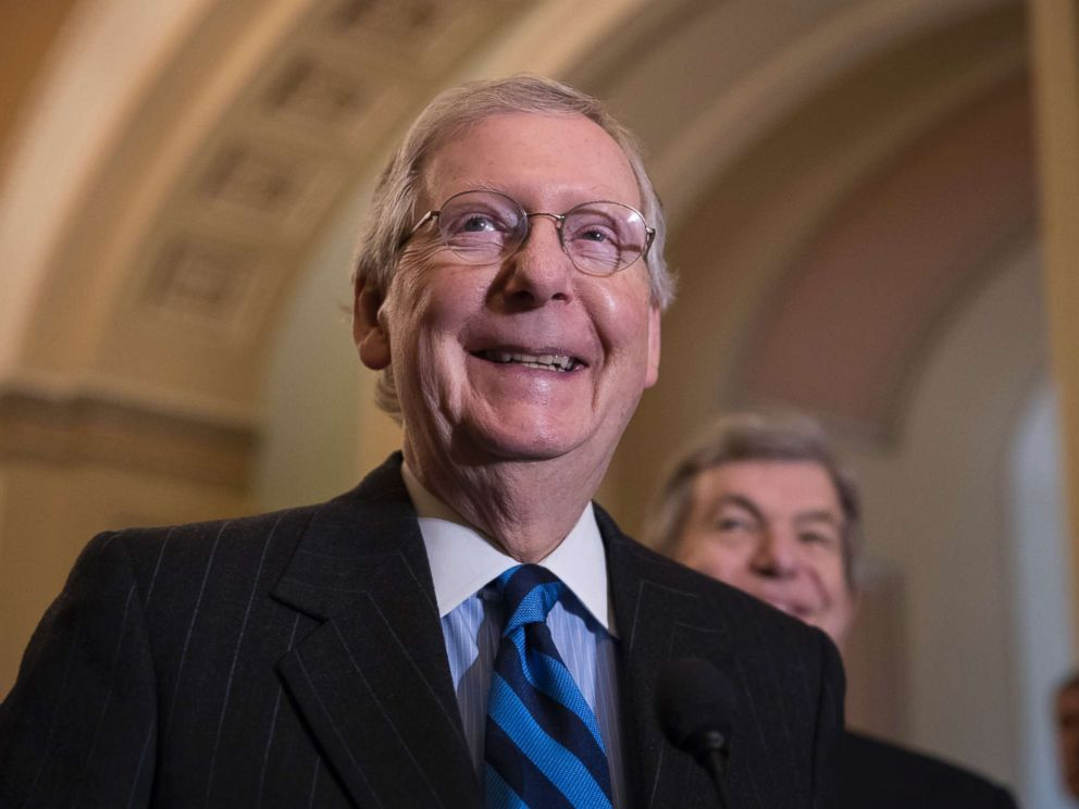 PHOTO: Senate Majority Leader Mitch McConnell, R-Ky., smiles as he meets with reporters as work continues on a plan to keep the government as a funding deadline approaches, in Washington, Feb. 6, 2018.