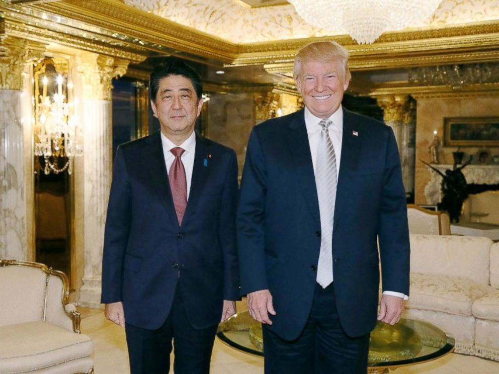 PHOTO: In this photo released by Japans Cabinet Public Relations Office, Japanese Prime Minister Shinzo Abe, left, and U.S. President-elect Donald Trump, right, pose for a photo during a meeting at Trump Tower in Manhattan, New York, Nov. 17, 2016.