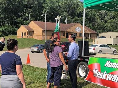 PHOTO: Julian Castro mingles with people who attended the unveiling of his People First Indigenous Communities Policy on July 26, 2019, in Tama, Iowa.