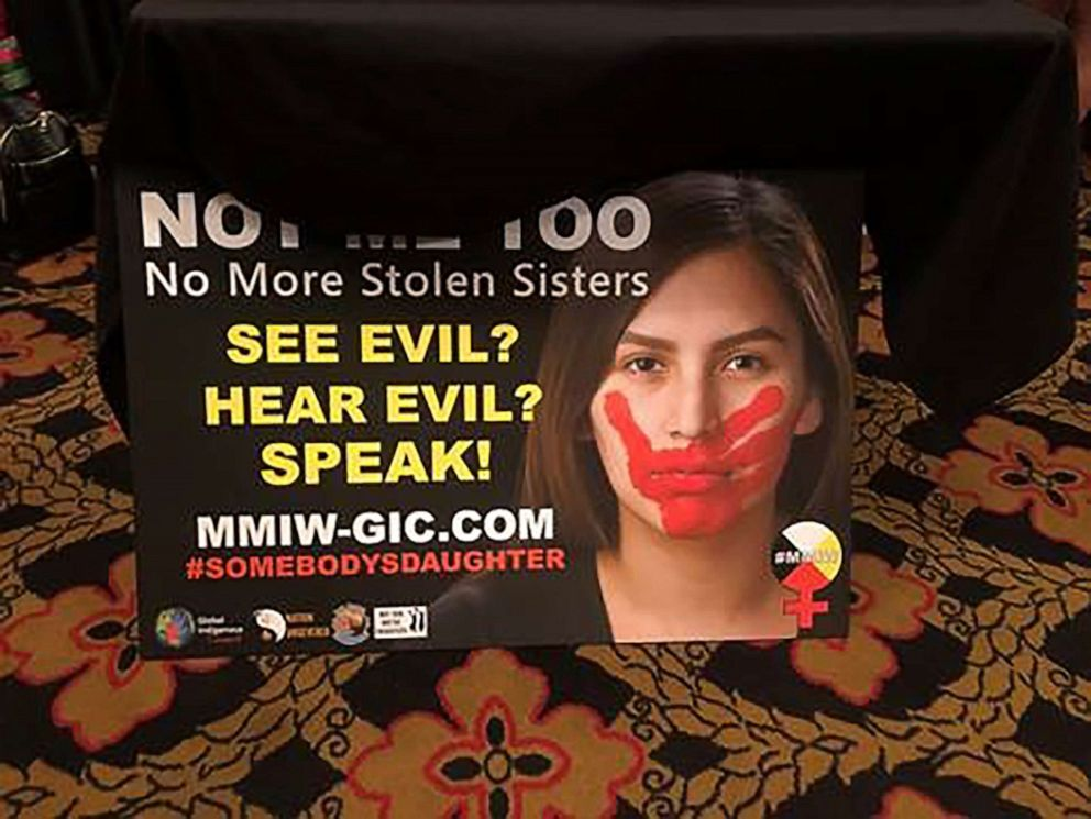 PHOTO: Not Me Too: No More Stolen Sisters is written on a sign that activists held up during the Frank Lamere Presidential Forum on August 19, 2019, in Sioux City, Iowa.