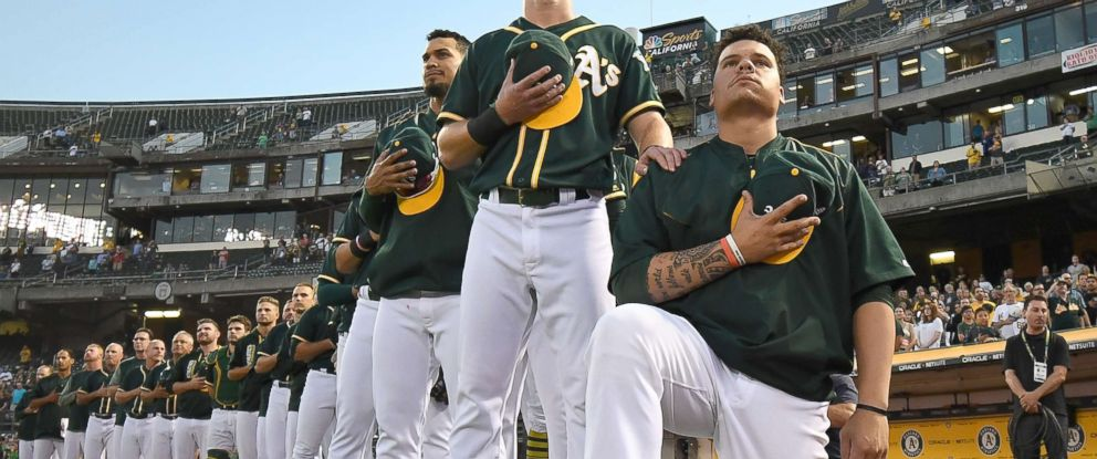 PHOTO: Bruce Maxwell of the Oakland Athletics kneels in protest next to teammate Mark Canha during the singing of the National Anthem at Oakland Alameda Coliseum on Sept. 26, 2017 in Oakland, Calif.
