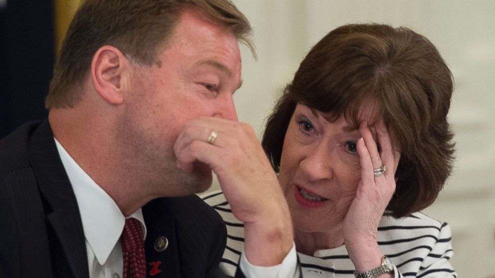 Sen. Dean Heller (R-NV) and Sen. Susan Collins (R-ME) talk prior to a meeting with President Donald Trump and other Republican Senators on health care in the East Room of the White House.