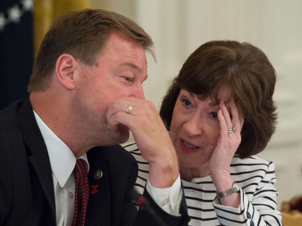 PHOTO: Sen. Dean Heller (R-NV) and Sen. Susan Collins (R-ME) talk prior to a meeting with President Donald Trump and other Republican Senators on health care in the East Room of the White House.