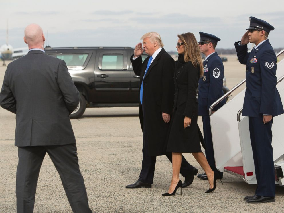 PHOTO: President-elect Donald J. Trump salutes the Air Force stewards, as he and his wife Melania arrive in the Washington, DC area on a US Air Force plane the day before his swearing-in as the 45th President of The United States.