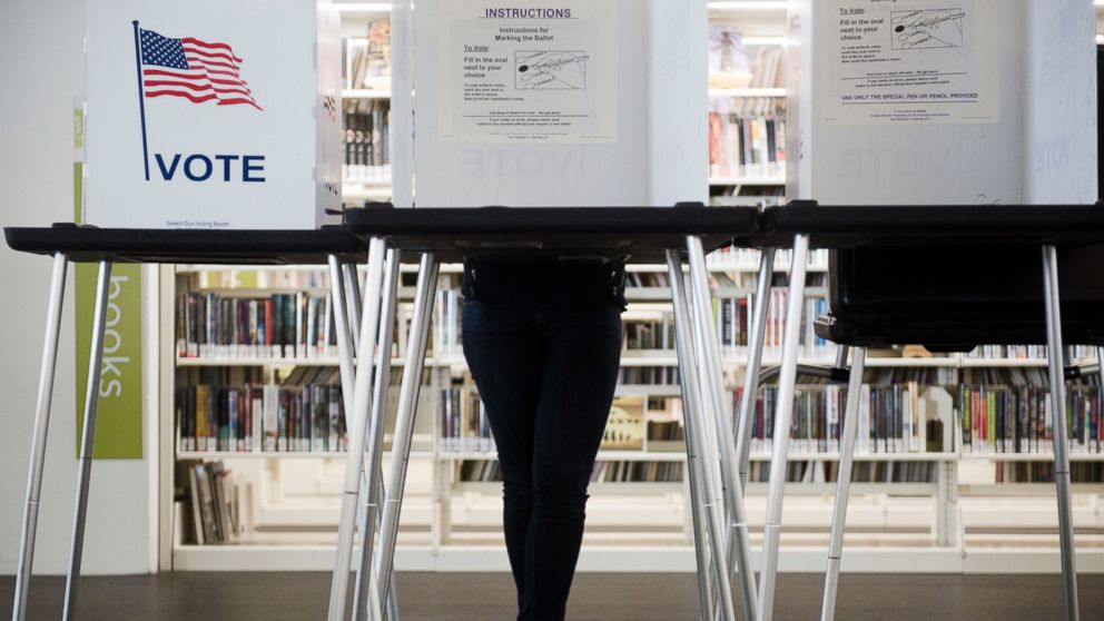 Early voting underway at the Central Library in Madison, Wisconsin, Oct. 14, 2016. A federal court invalidated much of Wisconsin's restrictive elections law, concluding in July that it discriminated against minorities. But the state's response to a court-imposed remedy has been somewhere between lackadaisical and defiant.