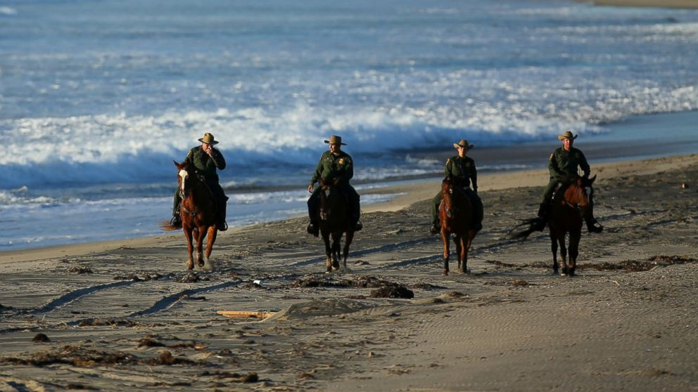 U.S. Border Patrol agents on horseback patrol along a beach just north of the U.S. and Mexico border near San Diego, Calif., Nov. 10, 2016.