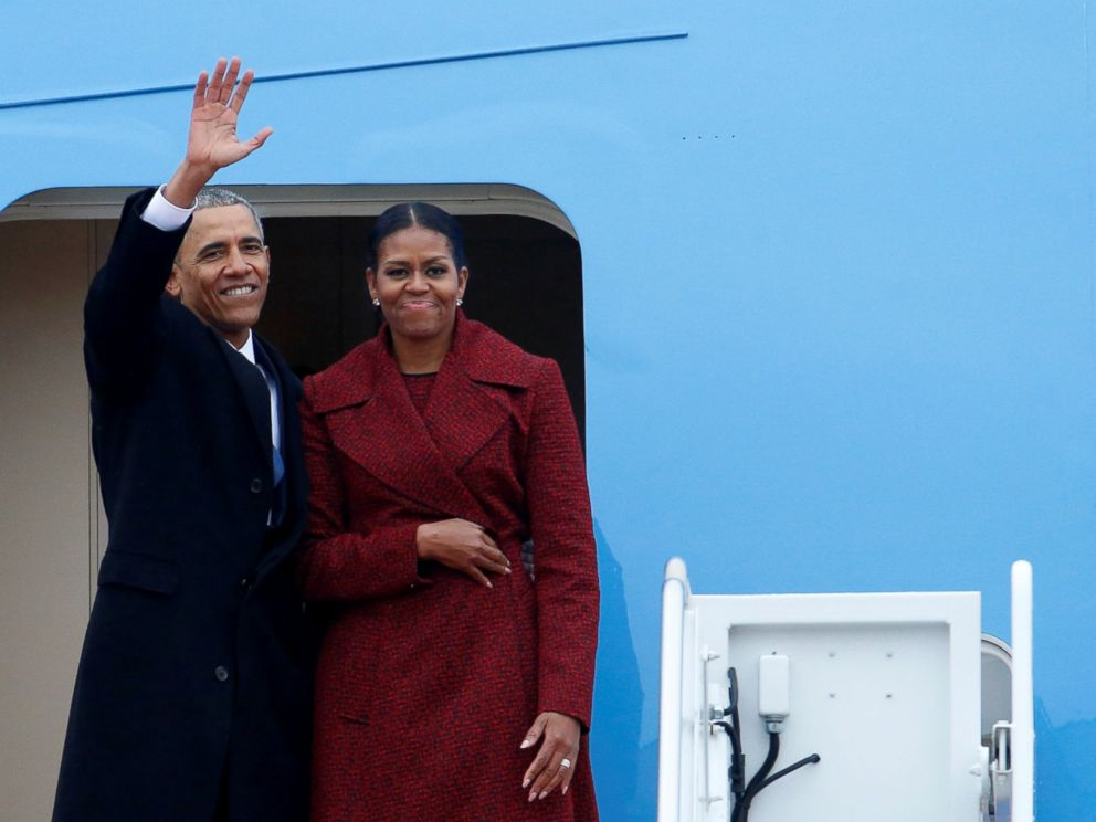 PHOTO: Former president Barack Obama waves with his wife Michelle as they board Special Air Mission 28000, a Boeing 747 which serves as Air Force One, at Joint Base Andrews, Maryland, Jan. 20, 2017.