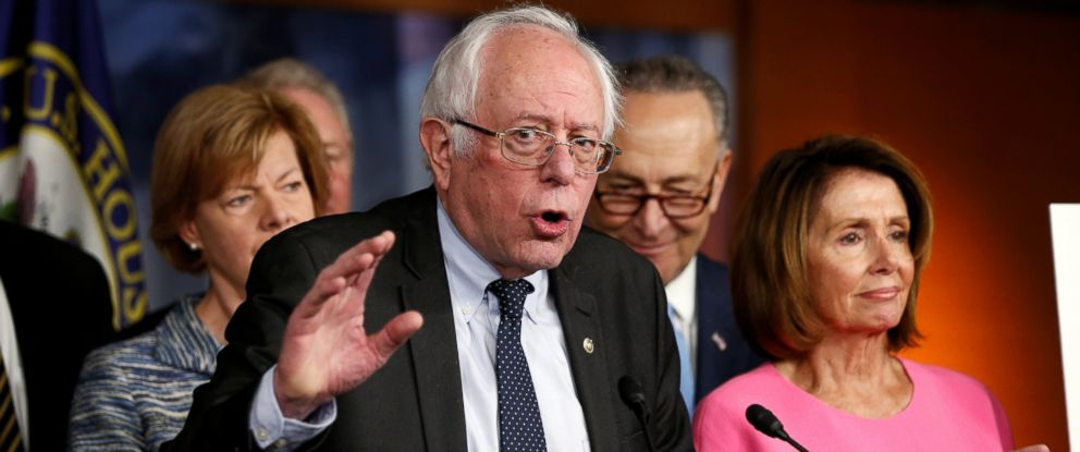 PHOTO: Former Democratic presidential candidate Bernie Sanders speaks to reporters as Senate Democratic Leader Chuck Schumer (2nd R) and House Democratic Leader Nancy Pelosi (R) stand with him on Capitol Hill in Washington, Jan. 4, 2017.