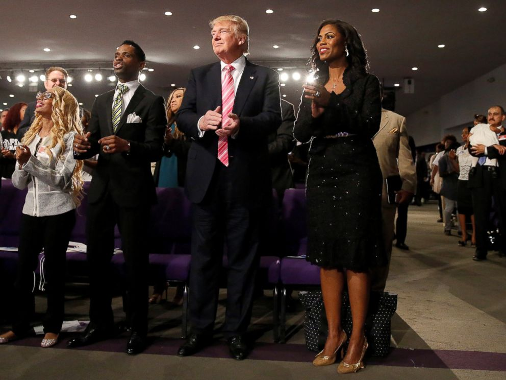 PHOTO: Republican presidential nominee Donald Trump and Omarosa Manigault attend a church service, in Detroit, Michigan, Sept. 3, 2016.