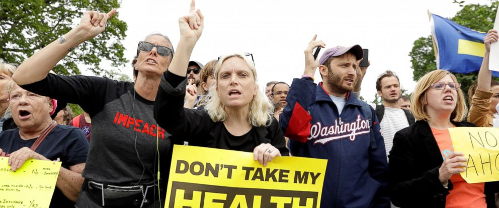 PHOTO: Demonstrators protest in front of the Capitol after the House of Representatives approved a bill on Thursday to repeal major parts of Obamacare and replace it with a Republican healthcare plan in Washington, D.C., May 4, 2017.