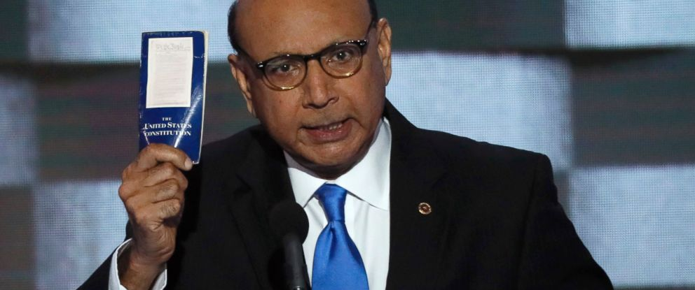 PHOTO: Khizr Khan offers to loan his copy of the Constitution to Republican U.S. presidential nominee Donald Trump, as he speaks during the last night of the Democratic National Convention in Philadelphia, July 28, 2016.