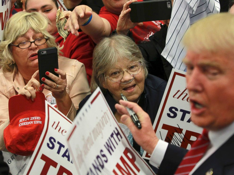 PHOTO: Supporters of Republican U.S. presidential candidate Donald Trump take pictures and seek autographs from Trump (R) at a campaign rally in New Orleans, Louisiana March 4, 2016.