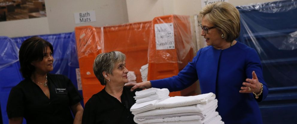 PHOTO: U.S. Democratic presidential candidate Hillary Clinton speaks to workers in the linen room at Caesars Palace during a campaign stop in Las Vegas on February 18, 2016.
