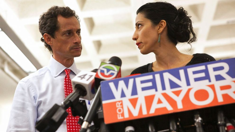Anthony Weiner and his wife Huma Abedin attend a news conference in New York, July 23, 2013.