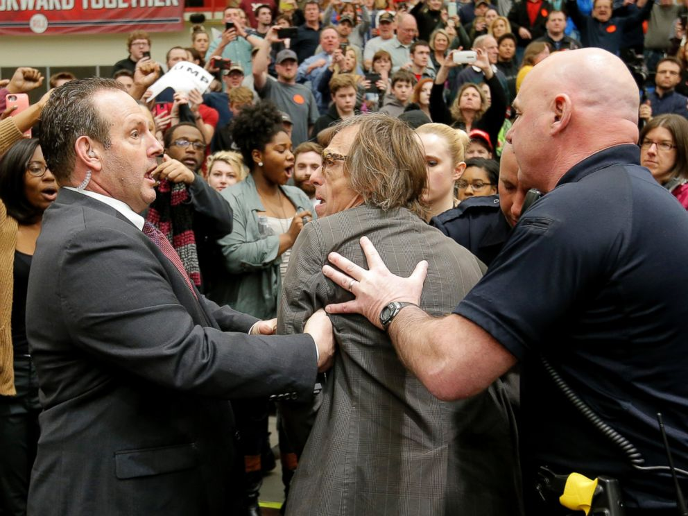 PHOTO: Photographer Christopher Morris is removed by security officials as Donald Trump speaks during a campaign event in Radford, Virginia, Feb. 29, 2016.