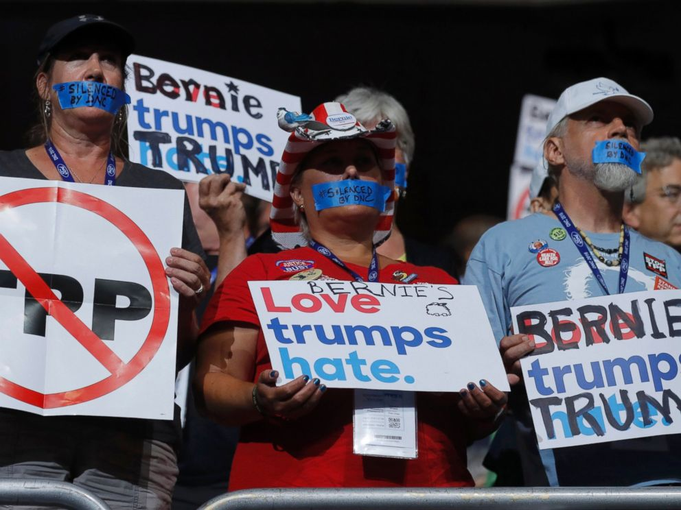 PHOTO: Supporters of Bernie Sanders wear tape across their mouths in protest on the floor at the Democratic National Convention in Philadelphia, July 25, 2016.