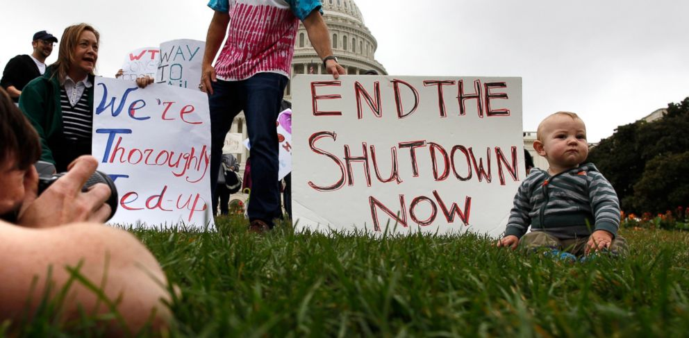 PHOTO: Mason Palmer (R), 10 months old is photographed by his father in front of federal workers demonstrating for an end to the U.S. government shutdown in front of the Capitol in Washington, Oct. 13, 2013.