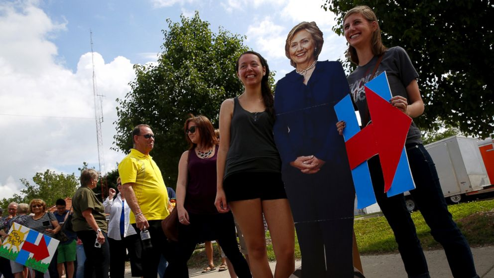Supporters have their picture taken with a life-sized cutout of Democratic presidential candidate Hillary Clinton at a campaign event in Des Moines, Iowa, June 14, 2015.