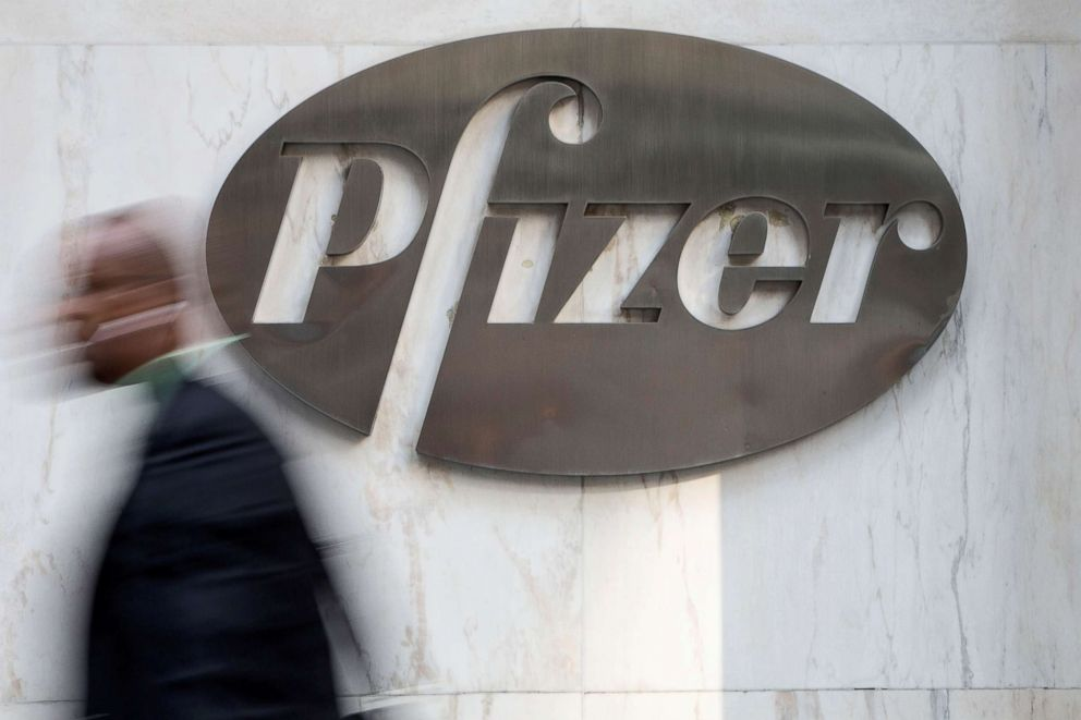 A man walks past Pfizer's world headquarters in New York, April 28, 2014.