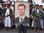 PHOTO: A protester loyal to the Shiite Muslim Al-Houthi group, also known as Ansarullah, holds a poster of Syrias President Bashar al-Assad during a demonstration against potential strikes on the Syrian government, in Sanaa Aug. 30, 2013.