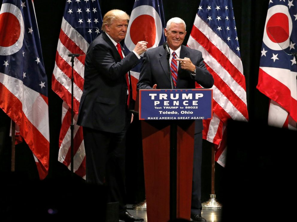 PHOTO: Republican presidential nominee Donald Trump brings vice presidential nominee Mike Pence onstage as he rallies with supporters in Toledo, Ohio, Sept. 21, 2016.