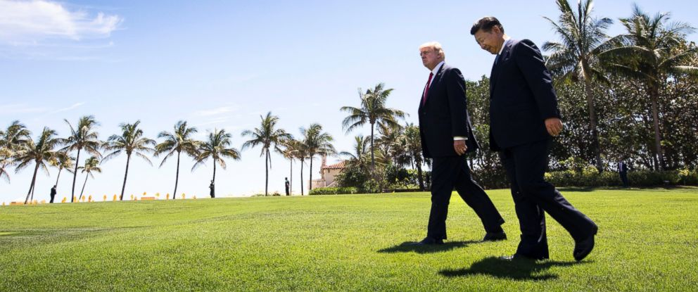 PHOTO: President Donald Trump walks with Chinese President Xi Jinping at Trumps Mar-a-Lago resort in Palm Beach, Fla., April 7, 2017.